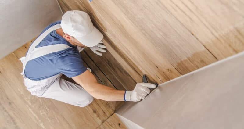Attach vinyl flooring to the wall