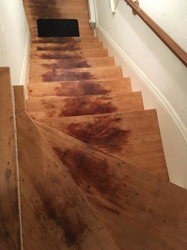 cleaning stained unfinished wood floors